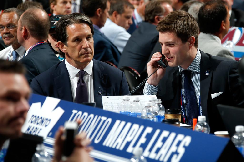 Toronto Maple Leafs draft Kyle Dubas talking on the phone